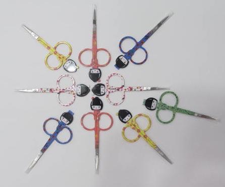 Cute doll head scissors